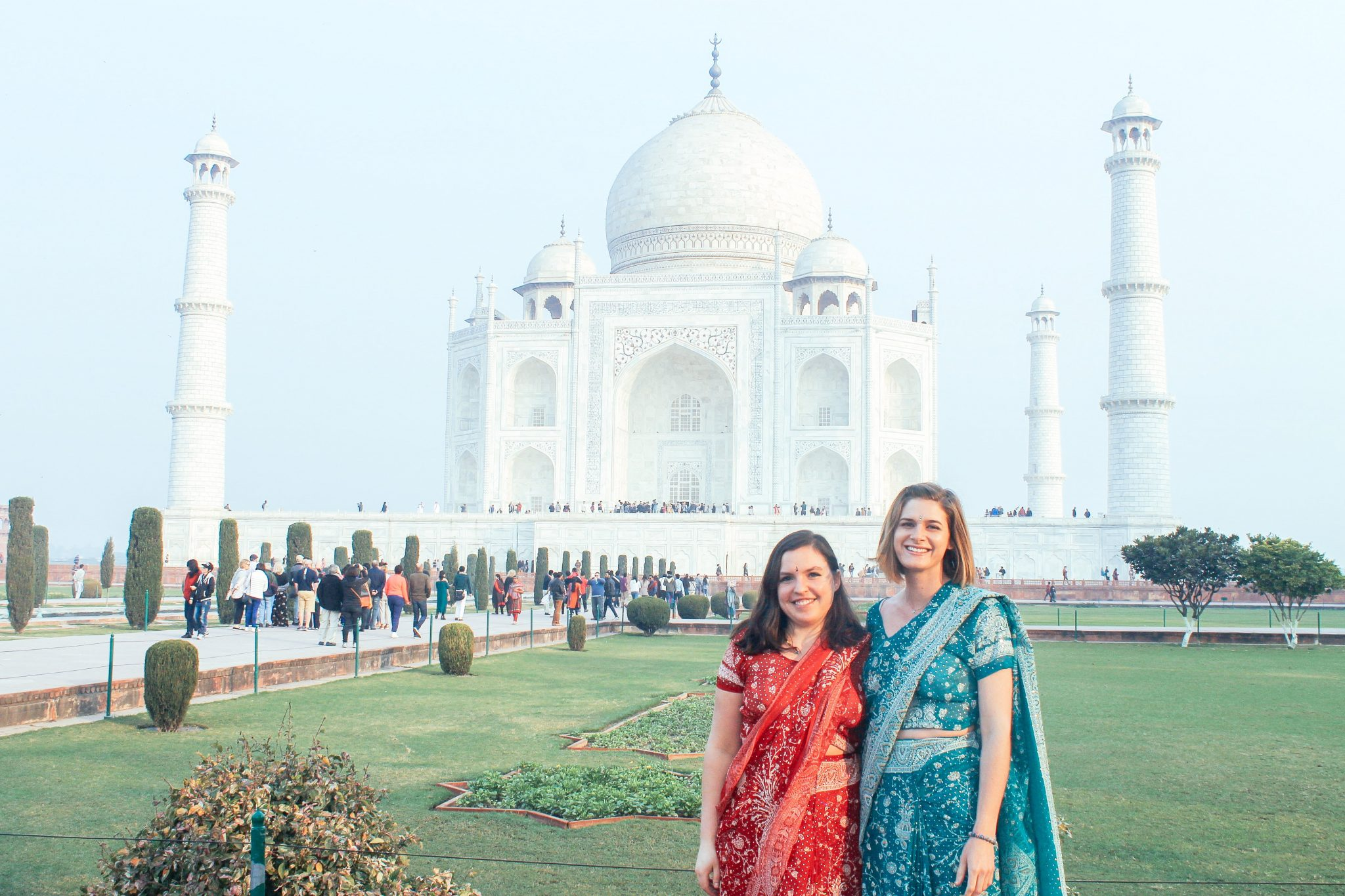 Wearing our saris at the Taj Mahal in Agra | India Travel Itinerary | Taj Tours