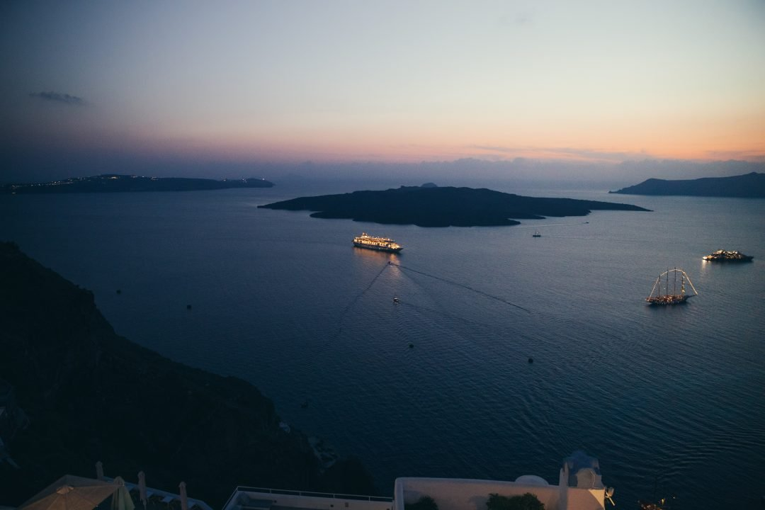 what to do in santorini, greece - sunset cruise