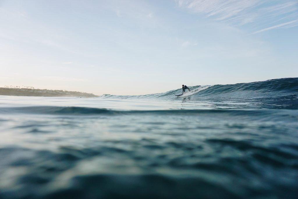 learn how to surf in california - malibu zuma beach